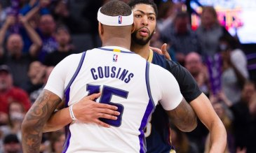 Feb 12, 2017; Sacramento, CA, USA; Sacramento Kings forward DeMarcus Cousins (15) and New Orleans Pelicans forward Anthony Davis (23) hug after the game at Golden 1 Center. The Sacramento Kings defeated the New Orleans Pelicans 105-99. Mandatory Credit: Kelley L Cox-USA TODAY Sports